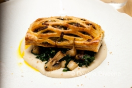 Wild mushroom, truffle and celeriac en croute, saute mushrooms and cavolo nero