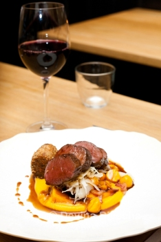 Roasted venison loin, venison shoulder croquette, butternut squash, saute bacon and choucrute